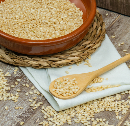 Brown rice contains more protein than white rice.Brown rice is slightly higher in fat, but its fiber content helps assimilate them better. Stok Fotoğraf