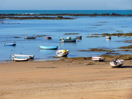 Fishing boats on the beach of La Caleta in the bay of the capital of Cadiz, Andalusia. Spain. Europe. Stock Photo