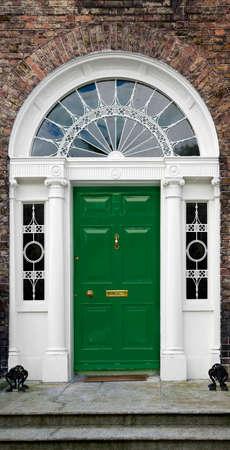 Georgian doorway in Dublin, Ireland, with cast iron fanlight and ionic columns Stock Photo - 1479406