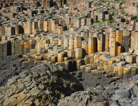 labourers: Basalt columns - natural volcanic rock formation at the Giants Causeway, County Antrim, Northern Ireland