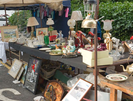 collectibles: BALLYCASTLE, N. IRELAND - AUGUST 31 2010 - Unidentified woman sells antiques at the Ould Lammas Fair on August 31, 2010 in Ballycastle, N. Ireland. This annual market is now over three centuries old. Editorial