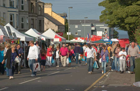 northern ireland: BALLYCASTLE, N. IRELAND - AUGUST 31 2010 - Unidentified people browse among the crowded traditional market stalls at the famous annual Ould Lammas Fair on August 31, 2010 in Ballycastle, N. Ireland.
