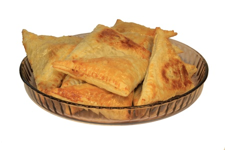A plate of empandas (or pasties) on a white background.