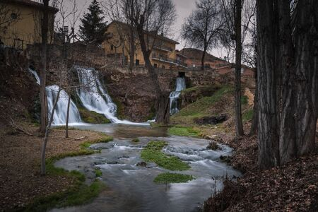 A waterfall of the Cifuentes river when it passes through the center of Trillo, Guadalajara, Spain.