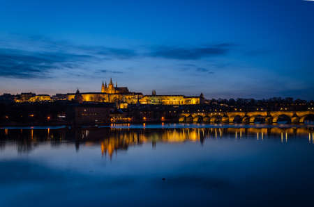 Night view of Prague at blue hour with the lights reflected on the Moldava river, Prague, Czech Republic