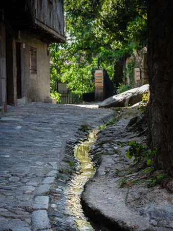 A small stream of water crosses the cobbled streets of the village of La Alberca, Salamanca, Spain