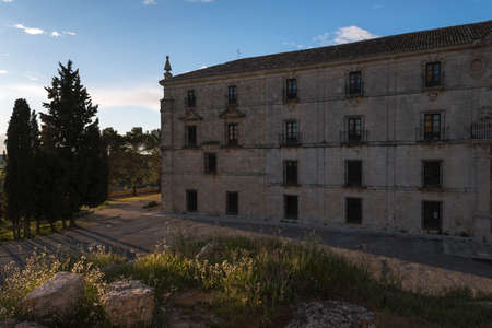 A view of the facade of the Monastery of Uclés at sunset, Cuenca, Castilla La Mancha, Spain Редакционное