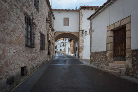 Wandering the historical streets of the medieval village of Uclés in spring, Cuenca, Spain Редакционное