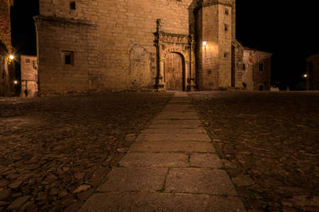 Night scape of Cáceres old town city with the church of Sant Mateo in the background, Extremadura, Spain