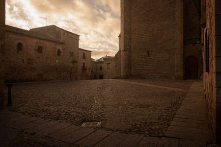 Street of the monumental old town of Cáceres city at sunset, Extremadura, Spain