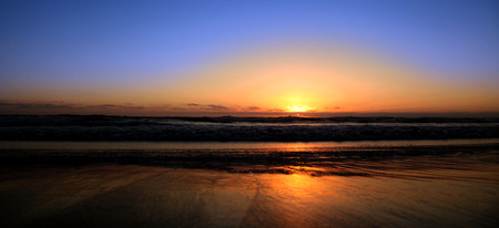 serine: Sunset on the Pacific Ocean Beach Coast Stock Photo