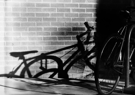 Silhouette Bike Shadow against Brick Wall Zdjęcie Seryjne