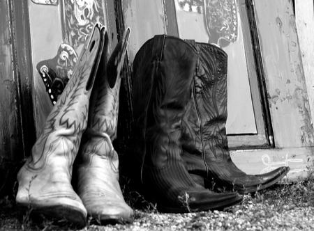 Cowboy or Cowgirl boots on the ground