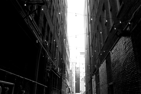 Lighted downtown Alley Way with hanging lights brick buildings