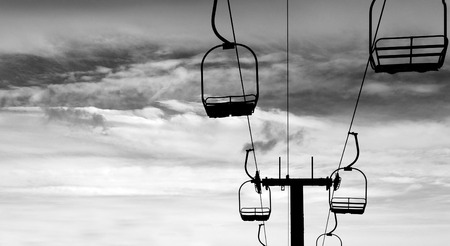 d       cor: Ski Lift chari in black Silhouette skiing snow background