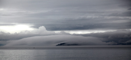 cor: Clouds Fog over an Vashon Island in Seattle Stock Photo