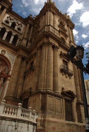 The front and one of the towers of Malaga cathedral photo