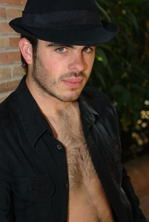 Interesting shot of the hatted model as he shows his hairy chest