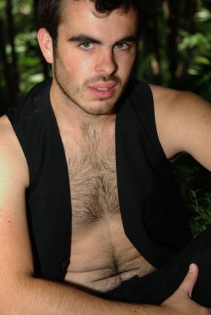 Here the model is wearing in black, showing his hairy chest photo