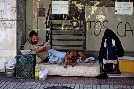 Seville, Spain, 14 November 2012.-  A homeless iby the demonstration in the General strike 39