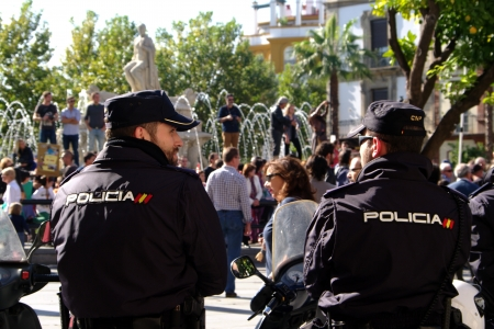 Seville, Spain.- 14 November 2012.- A pair of pocement in front of the demosntrators during the general strike Editorial