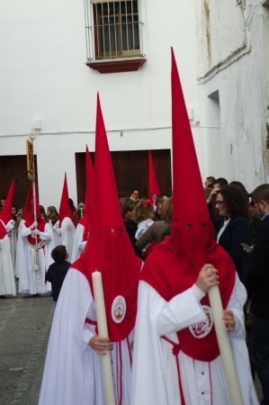 carmona: Carmona, Seville., Spain.- 27th March 2013.- Holy week procession.- Penitents in red and white.- 36