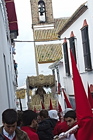 carmona: Carmona, Seville., Spain.- 27th March 2013.- Holy week procession.- Float in a narrow street.- 32
