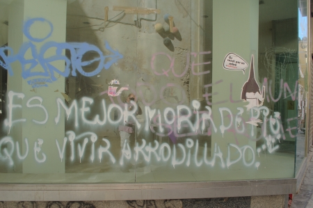 Malaga (Spain) 28th June 2013: Street photography. Protesting with graffiti