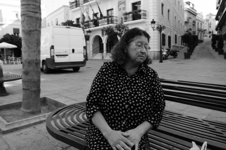 pgotography: Almu�ecar  Granada  Spain  18th July 2013 - Street pgotography - Old lady sitting at a bench