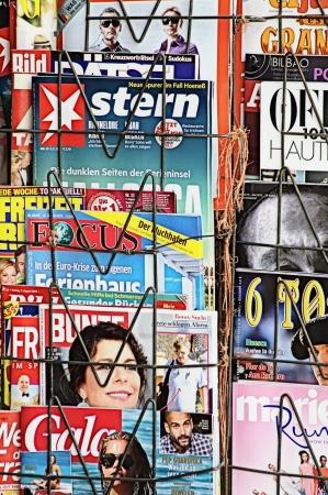 Malaga  Spain  12th August 2013 - Street photography  Magazines on a kiosk