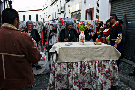 carmona: Carmona - Seville - Spain - 8th March 2014 - Carnival celebration - old ladies on armchairs at the table