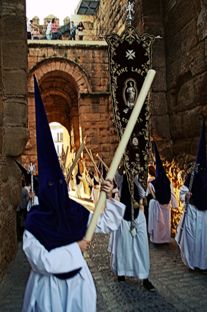 carmona: Carmona  Seville  Spain, 16th April 2014  Holy Week celebbrations  Penitents through an old arch 9 Editorial
