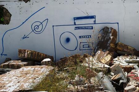 carmona: Carmona  Seville  Spain 24th June 2014 - Graffiti in Carmona - Radiocassette on the wall