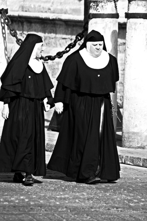 Seville, Spain, 18th August, 2014 - Urban life XXXIII - Nuns walking in the street
