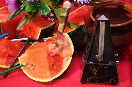 metronome: Still life with watermelon  and metronome 6 Stock Photo