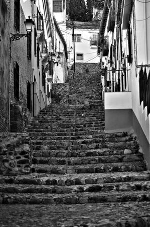 granada: Typical narrow street in Granada Stock Photo