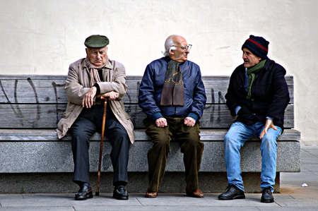 Seville, 15th February 2005 - Urban life - Old men sitting on a beach