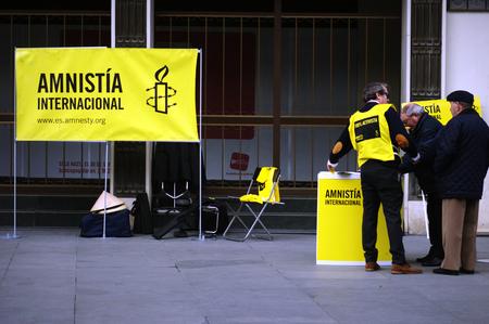 amnesty: Seville, 15th February 2005 - Urban life - Amnesty Internationa defending human rightsw