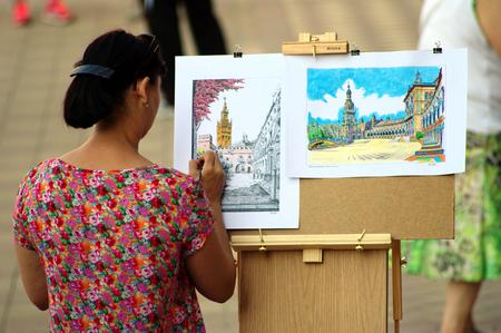 urban life: Spain Seville 2nd June 2015 Urban life. Female painter