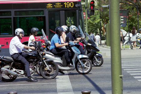 trafic: Seville Spain 2nd June 2015. Urban life. Motocycles Editorial