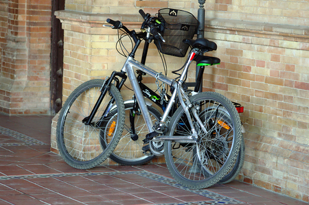parked bikes: Sevilla -Spain- July 29 2015 - Urban life - Bikes parked in Spain square