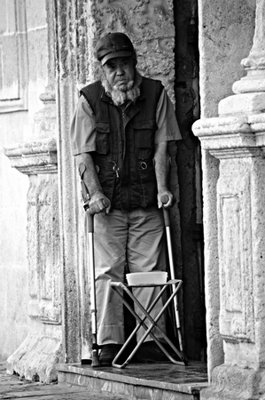 beggar: Sevilla - Spain - 19 July 2015 Urban life - Beggar with crutches