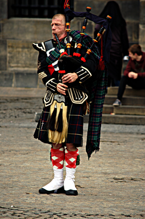 scot: Netherlands, Amsterdam, 11th, October, 2015 - Showman in Dam square A scot playing the pipe