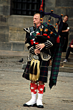 scot: Netherlands, Amsterdam, 11th October 2015 - Scot musician in Dam square