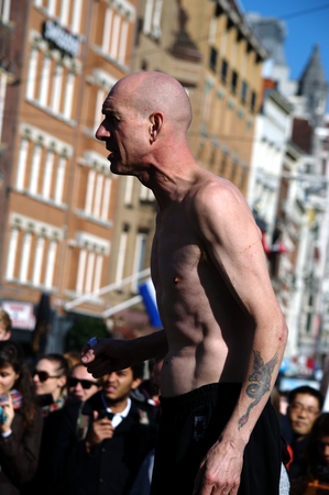 showman: Netherlands, Amsterdam, 11th October 2015 - Showman in the street