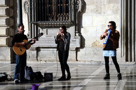 granada: Granada - Spain 26th December 2011 - Urban life - Street musicians Editorial