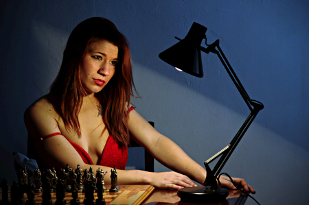 chess player: Chess player with light Stock Photo