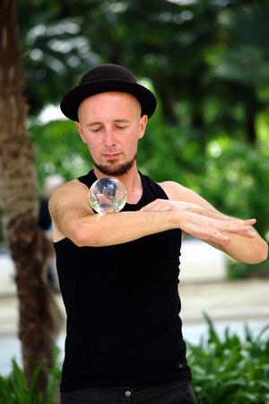 juggler: Seville - Spain - 30th May 2016 - Juggler with crystal ball Editorial
