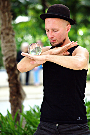 seville: Seville - Spain - 30th May 2016 - Juggler with crystal ball Editorial