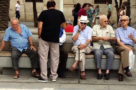 Seville, Spain, 14th September 2016, Seniors sitting in the sun